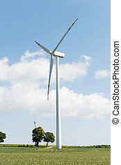 Windmill power generation over sunny landscape. - Windmill...