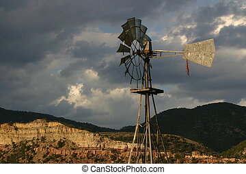 Windmill spinning against stormy evening sky in the Colorado...