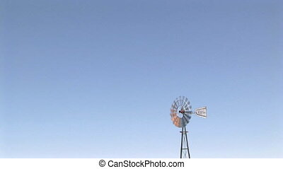 Windmill against blue sky