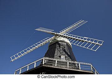 Windmill towards blue sky