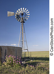 windmill, water pump and concrete tank in shortgrass prairie...