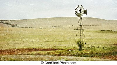Windmill water pump - Landscape with windmill water pump on...