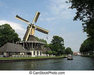 windmill4061 - Turning in the wind, a Dutch windmill along...