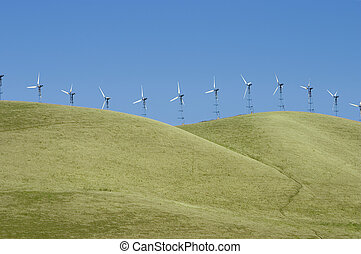 Windmills 1 - A line of windmills on rolling hills in...