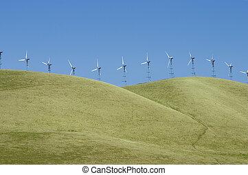 Windmills 1 - A line of windmills on rolling hills in...