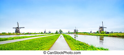 Windmills and water canal in Kinderdijk, Holland or Netherlands, panoramic view. Unesco world heritage site. Europe.