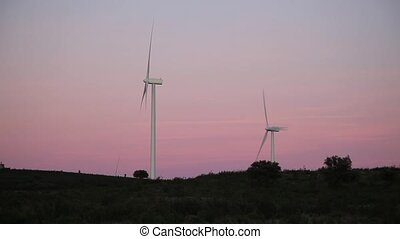 windmills at pink sunset