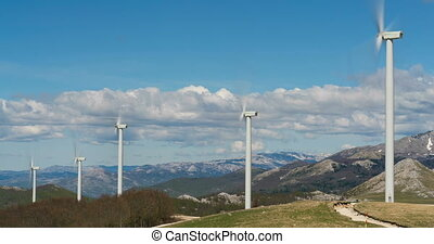 Windmills converting wind energy into electricity, time lapse