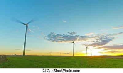 Windmills generators at sunset, tim