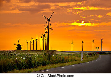 Windmills in front of colourful sunset sky