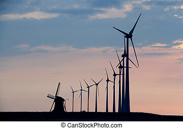 Windmills in front of evening sky