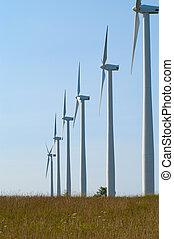 Windmills in Row - Line of windmills extending to horizon of...