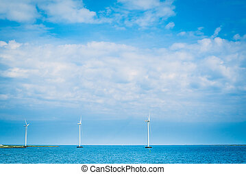 Windmills in the blue ocean
