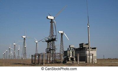 windmills in the field - working windmill near the road in...
