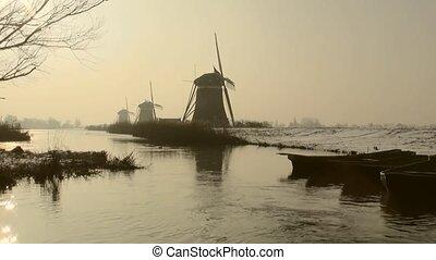 Windmills in Wintersun in Holland. - The three mills were...