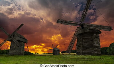 Old windmills on sky background. DSLR, Raw quality time lapse.