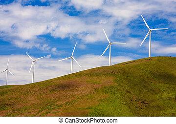 Windmills on a Green Hill