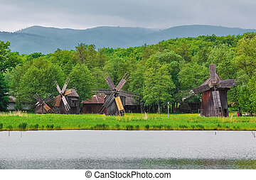Windmills on the Bank of Lake