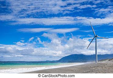 Windmills power generators at ocean coastline. Philippines -...