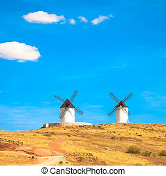 Windmills, rural green fields and blue sky. Consuegra, Spain
