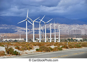 Windmills rotating and producing clean energy, electric...