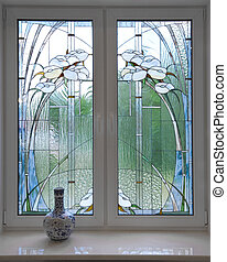 Window. A modern stained-glass window. A modernist style.