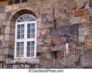 Window and stone wall of a church