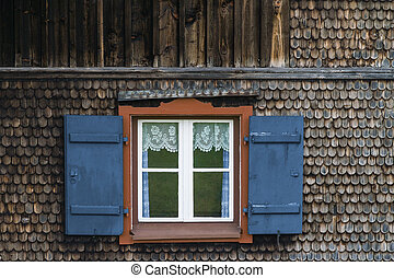 Window at a typical old bavarian farmhouse in the alps.