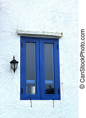 Window blue wall outdoor - vintage style.