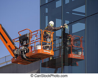 Window cleaner and installer - Window installer on a...