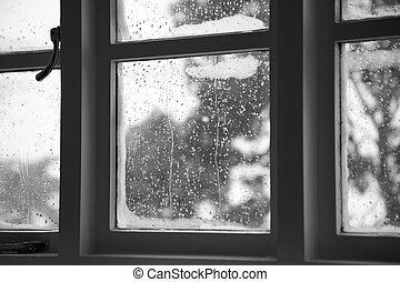 Window condensation - A glass window showing the water...