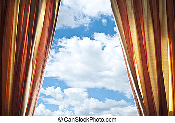 Window curtains with view of clouds and sky