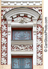 Window decorated with stucco.