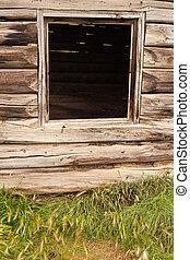 Window frame in old log cabin