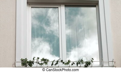 Window Frame With Sky Cloud Reflect - Home Exterior With...