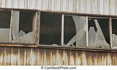 window glass broken abandoned warehouse factory - window...