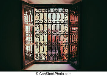 Window grill ornament in Marrakech in Morocco. - View of a...