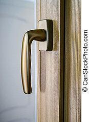 Window handle on fiberglass window. Gold color. Interior ...