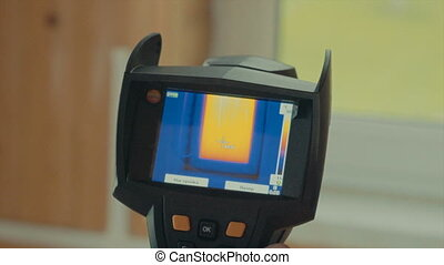 window heated, the readings of a thermal imager