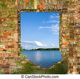 window in a brick wall with a kind on the river