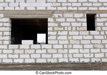 window in a new brick house