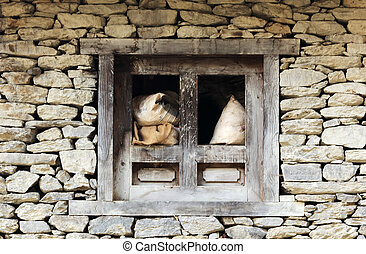 Window in a stone house in the mountains of the Himalayas. Evere