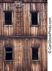window in abandoned house broken