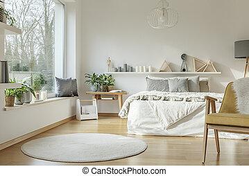 Window in bright bedroom interior