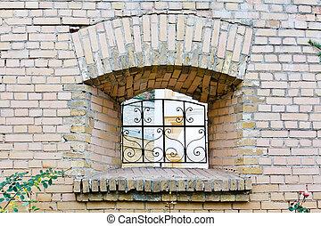 Window in monastery garden wall