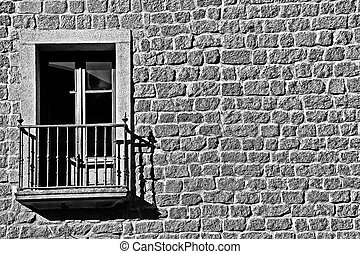 window in old stone building