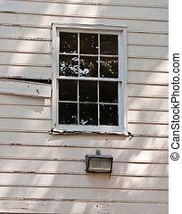 Window in Old Wall Needing Paint