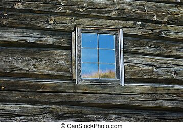 Window in old wooden wall