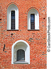 window in red brick wall