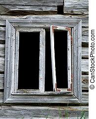 Window in ruined wooden building